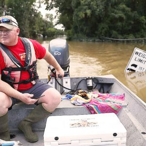 Rising above: Louisiana floodwaters no match for neighborly love