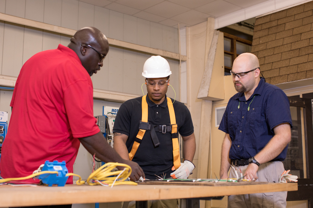 Students in the electrical course at NBRITI demonstrate safety best practices.